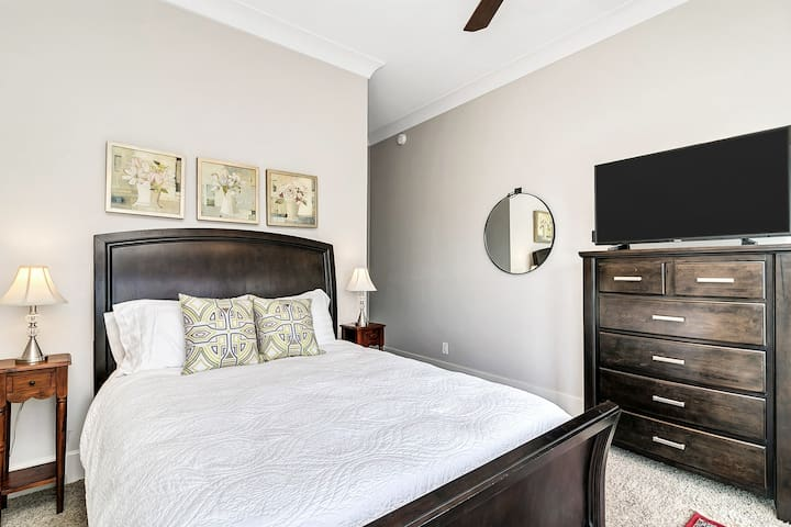 The lower level guest bedroom features a queen bed, HDTV, and ensuite walk-in shower.