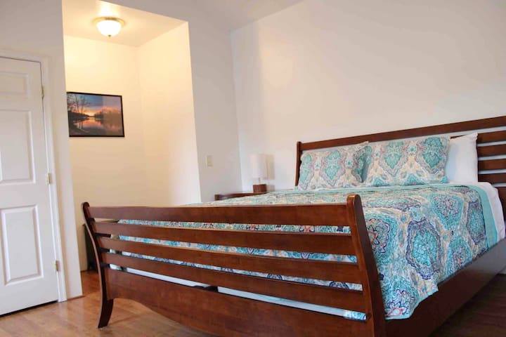 """Master Bedroom--includes a attached full bathroom with double sinks, bathtub with shower and a walk-in shower. It also has a large walk-in closet, a closet with full size washer and dryer is also located in this room & 55"""" smart tv (no cable)."""