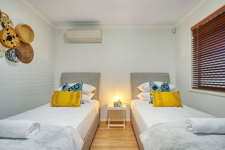 A secondary bedroom features two twins beds—which can be connected upon request— and air conditioning
