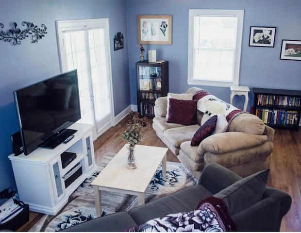 Living room with natural light from original French doors which lead to a covered porch area. Verizon Fios Internet & Cable for all your entertainment needs.