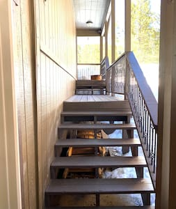 Path to front door.  Entrance is to the left at the top of stairs.