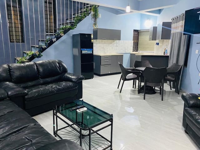 Hall room - furnished with Air conditioner, sofa set with center table, Coffee Table with Easy Chairs and LED TV with Satellite Live