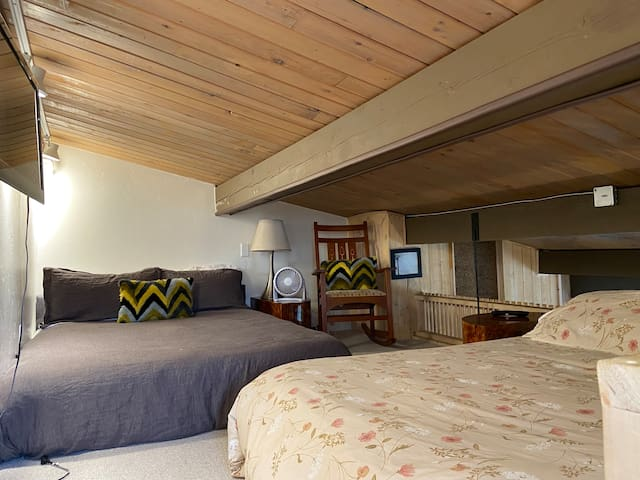 Loft sleeping area with two queen beds