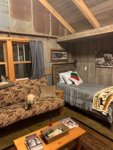 Bunkhouse with many amenities. Two single beds, two pull out beds! Sleeps 2-4!  (2 additional fold up single beds can be added to the adjoining game room)  The Bunkhouse is Included with the Farmhouse! Note:  guests use farmhouse bathrooms/showers