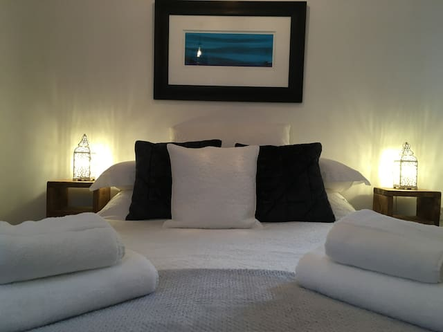 Comfy double bed with low end for taller guests