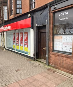 The entrance door is situated between Ladbrokes and Costa Coffee. Once inside there are two sets of stairs to the first floor property