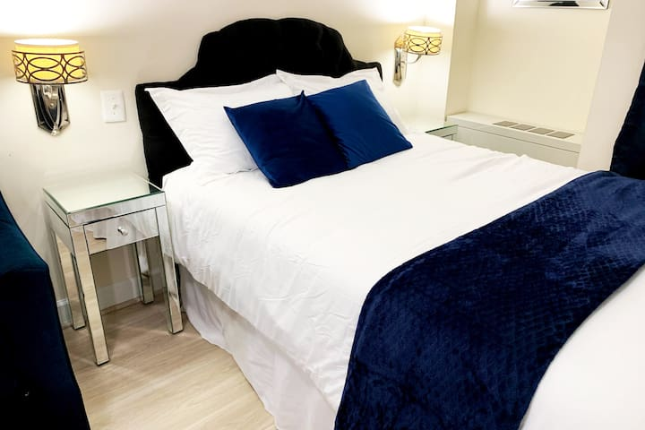 Comfortable, full-size bed with crisp white linens and a comfortable duvet cover for a good night's sleep.