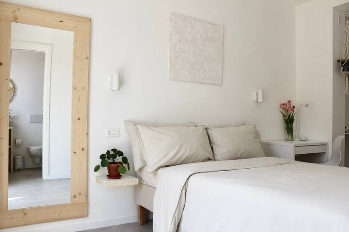 Double size bed and organic cotton pillows.
