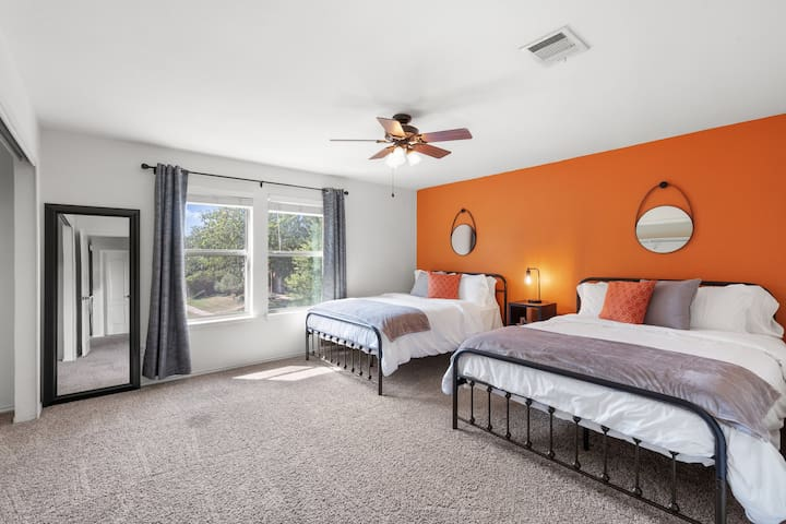 Second bedroom is large with 2 queen size beds, a large closet, and a ceiling fan.
