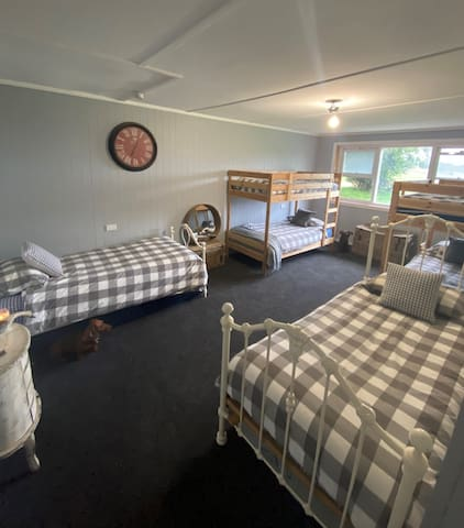 Bunk room. 2 adult size single beds. 4 smaller bunk beds