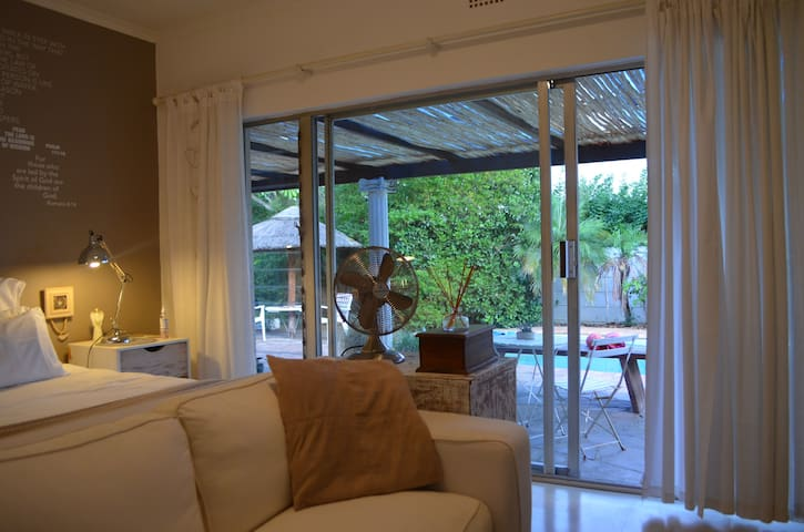 Sliding doors overlooking the pool. Comfort and style awaits you.