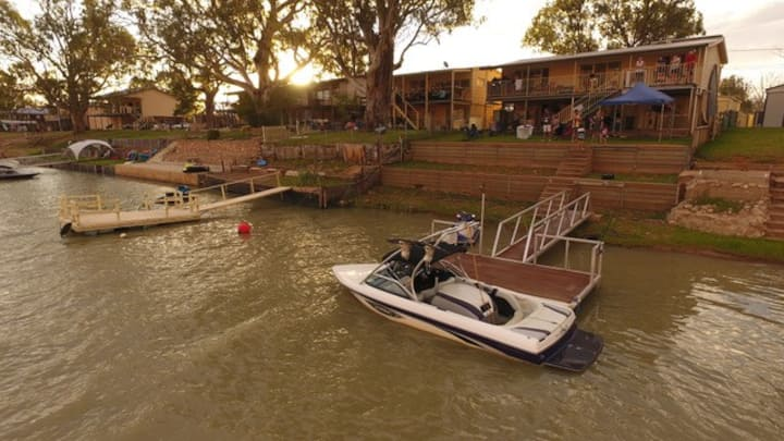 Riverfront holiday home with private pontoon