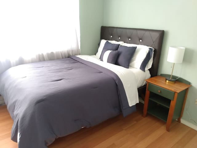 third bedroom with queen bed and closet