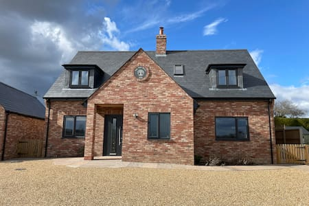 Plenty of room to park with good clearance around doors.  Easy access through front door and all ground floor including bedroom and en-suite are on same level