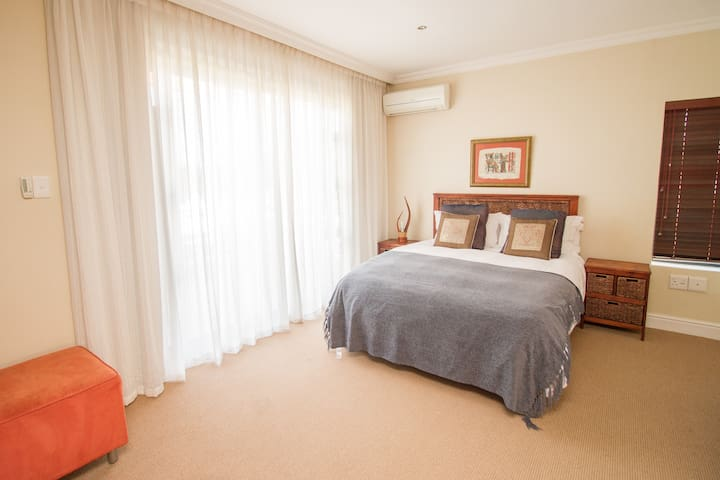 Upstairs Bedroom 3 - Has own sliding door and access to private balcony.