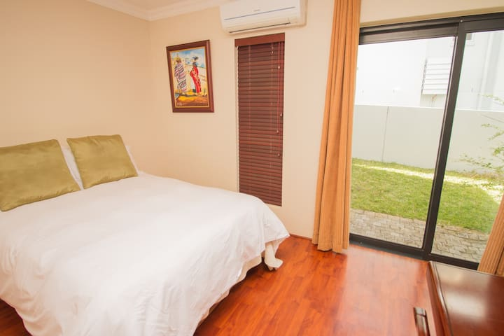 Downstairs bedroom - suitable for 1 or 2 people. Includes your own sliding door.