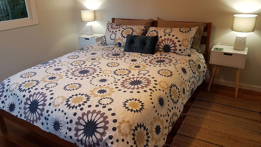 Main bedroom, queen bed with generous king size doona and additional bedding