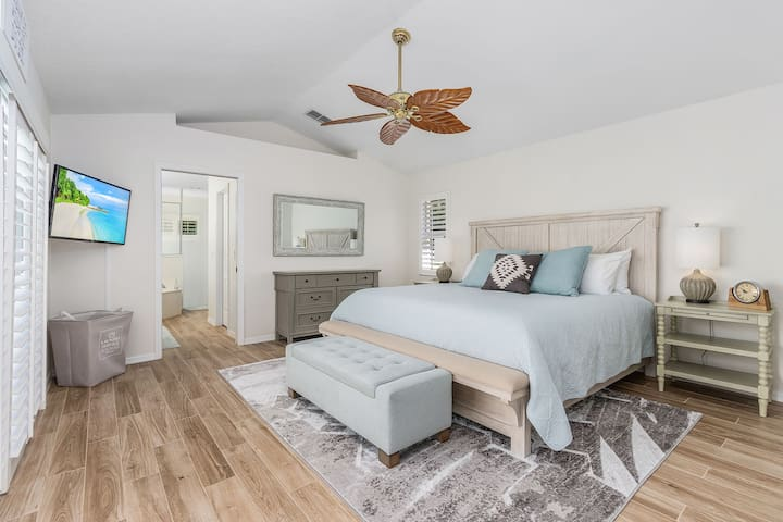The large master bedroom is light and airy with a king bed, TV, huge walk in closet and spacious master ensuite bathroom.
