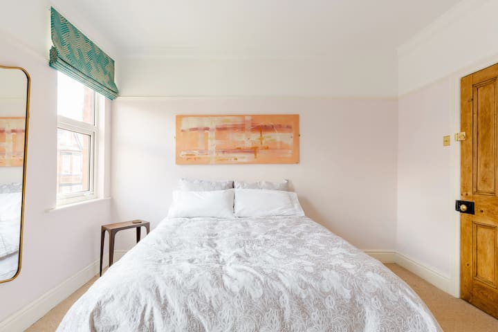 The master room with a spacious king-size bed