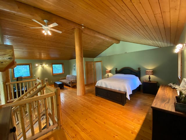 Grand loft area which includes Queen size bed, futon, large bathroom, TV and private deck with views of the lake