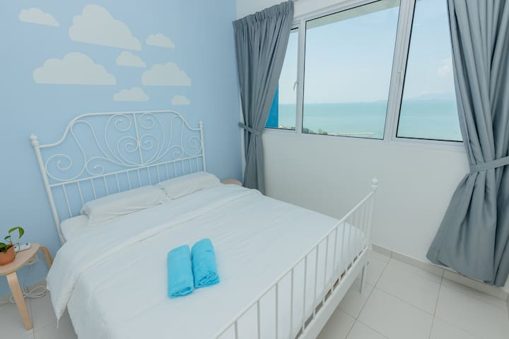 Seaview master bedroom with queen size bed..