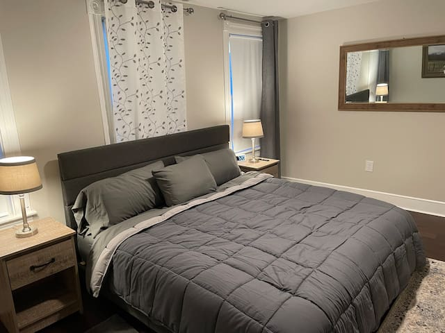 Master Bedroom with a Nectar King bed, Roku TV, & Iron/Ironing board.