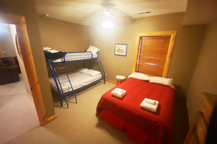 Basement Bedroom with Queen and Twin over Full Bunk Bed.