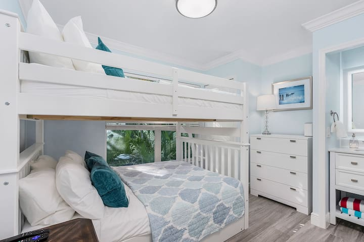 The second bedroom has full-size bunk beds, TV and an ensuite bathroom with shower.