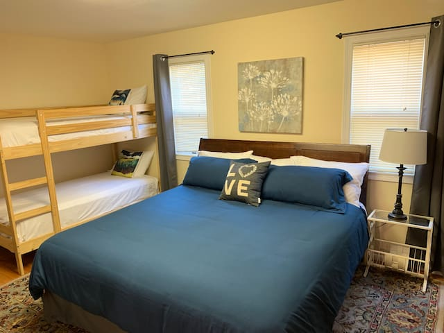 The downstairs family bedroom has an eastern king-size bed and twin bunk beds. Blackout shades keep the room insulated and dark. This room sleeps up to 4 people.