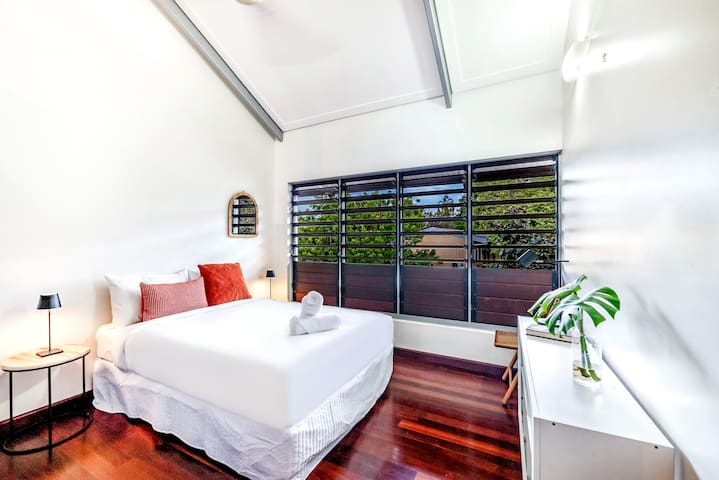 A third bedroom comes with streams of natural light, a plus double bed dressed in quality linen and wardrobes