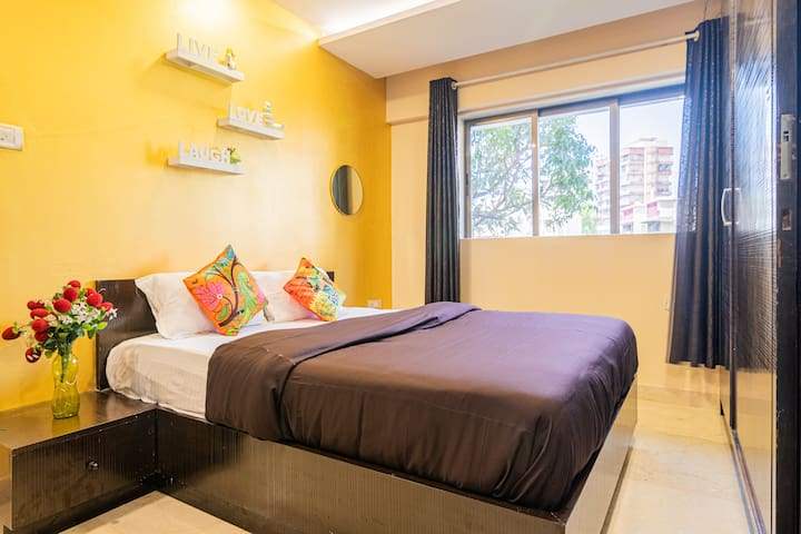 Bedroom 1 - Bright, breezy with a comfortable queen size bed, 10 inch spring mattress, fresh linens and a huge wardrobe to accommodate all your belongings for long stays