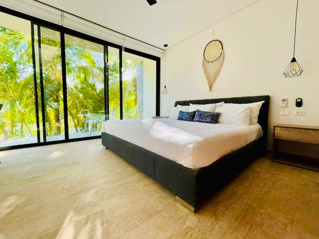 A comfortable king size bed with king size pillows and beautiful nature view