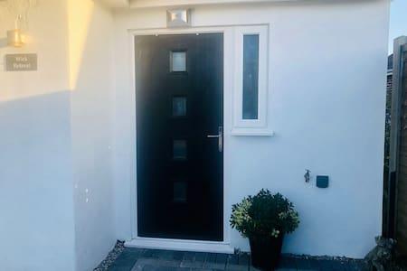 Motion sensor light above entrance door. Additional lights at front of property