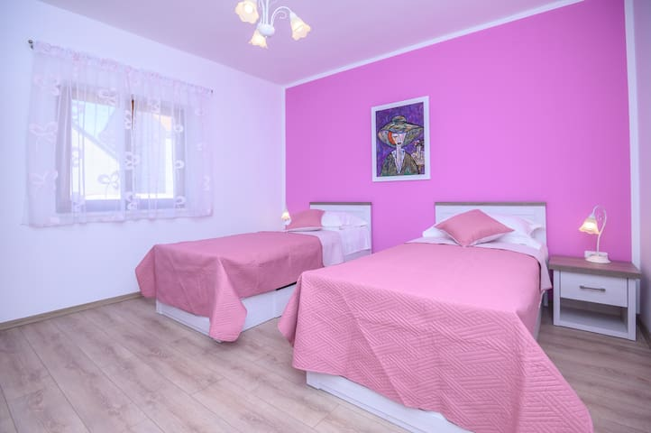 Bedroom No2 with two single beds 90cmx200cm and view