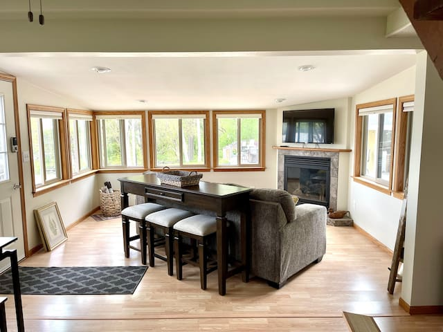 Sun Room. There is now a pub table with 2 stools in the corner.  (See pic.)