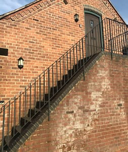 The stairs well lit to the front door , parking drive is next to the Granary