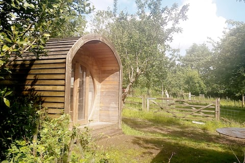 Wooden pod in the orchard of a 17th C farmhouse