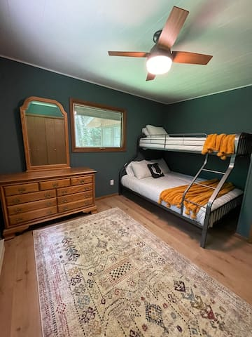 Our 1st floor River Guest Room includes a Twin XL over Queen bunk bed.