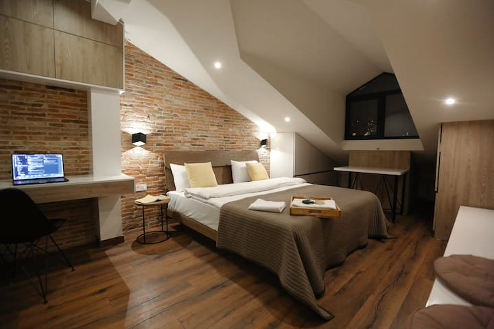 Cozy master bedroom with comfy large bed and work space.