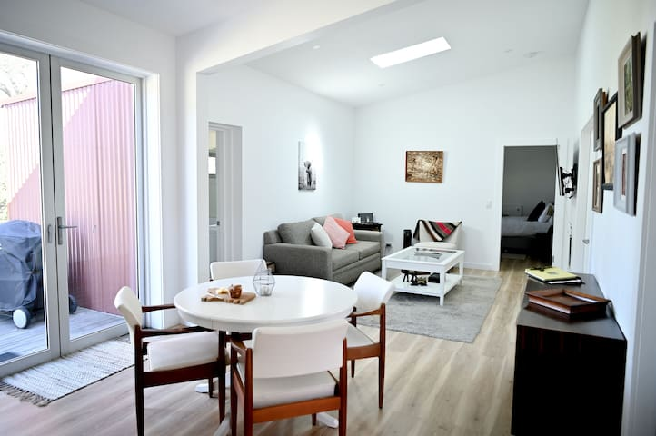 Dining area and a very comfortable living area. Large smart TV. Good heating and a sky light for natural light.  Bbq directly outside on deck.