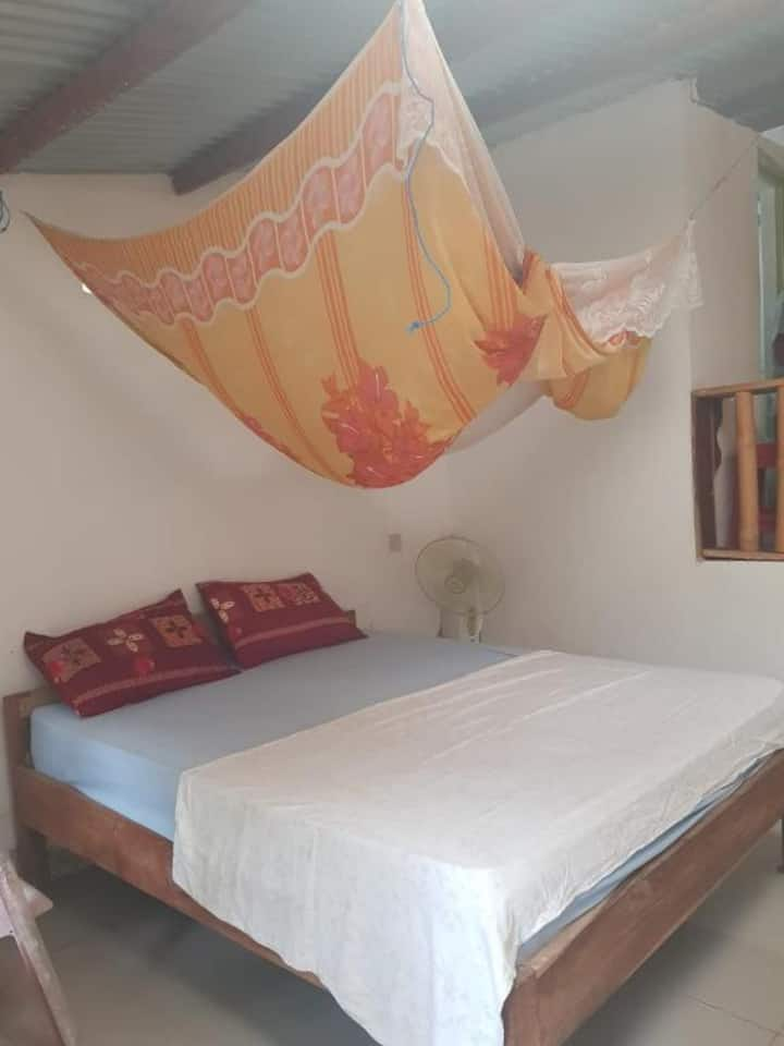Cozy Room with Fan at Palulu Garden Homestay