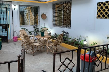 Private garden space with some traditional chairs and some night lights to set your mood for an afternoon relaxation. Dust bin available and a smoking section.