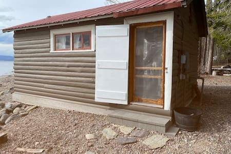 The cabin sits on a gravel beach, we have a few stepping stones and one step for entry.
