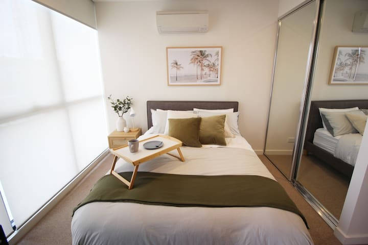 2nd bedroom with dual sunscreen and blockout blinds to all windows. Street view