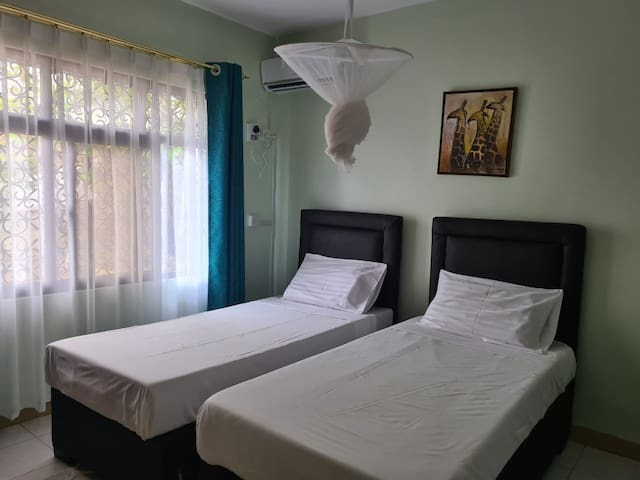 Bedroom 5 -Lower room with 2 comfortable single beds