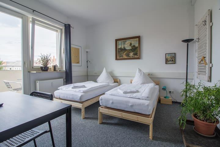 Doppelzimmer mit Balkon zum Hinterhof