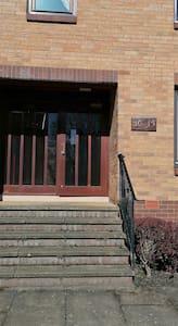 Main entrance accessing security door.