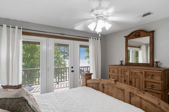 Wake up to a gorgeous view of the lake--close the mini blinds for a nice, long sleep or open them up for a great sunrise!