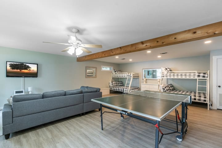 Downstairs living room and bunk area--TV with cable and streaming available down here as well! You'll enjoy hours of fun on the competition-grade ping pong table!