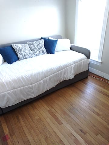 The second bedroom comes equipped with a twin day bed with rollout trundle.  Beds are comfortable and easy to pull out to support extra guests.